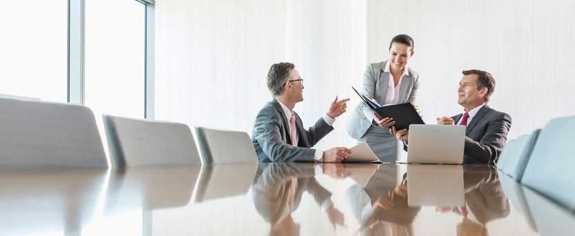 Pictures of executives in a meeting